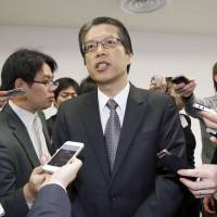 Skymark Airlines President Masakazu Arimori speaks to reporters in Tokyo on Jan. 29 after the ailing carrier announced it was seeking court protection. | KYODO