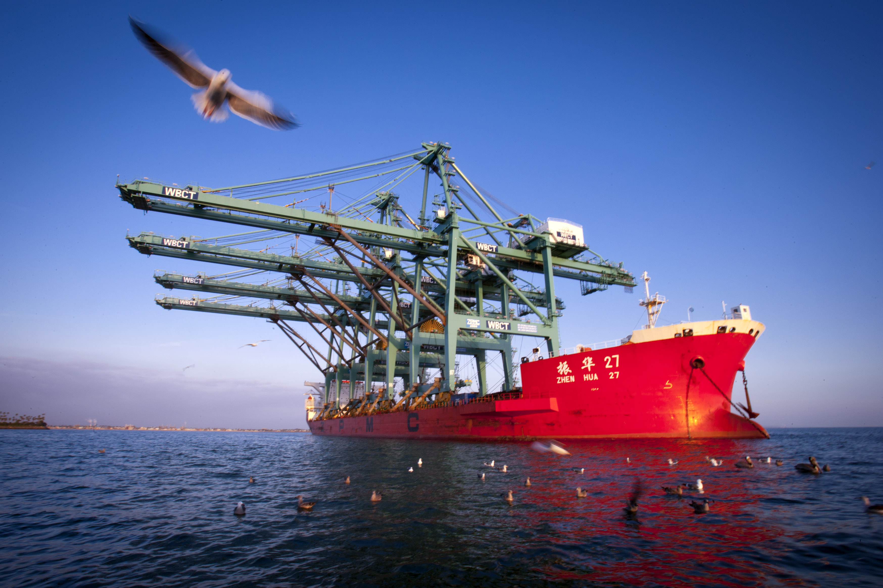 A ship carrying container gantry cranes manufactured by Shanghai Zhenhua Heavy Industry Co. Ltd. is seen in January 2011. Taiwan turned to the state-run mainland Chinese shipper to get vital materials to a $100 million port it is building in the disputed Spratly archipelago in the South China Sea. | BLOOMBERG