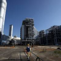 Tokyo Electric Power Co.'s combined-cycle thermal power station in Kawasaki is pictured in August. The nation's top utility and Chubu Electric Power Co. will unite their thermal power operations in a joint venture with a dominating market share. | BLOOMBERG