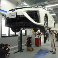 Toyota Motor Corp.'s Nagoya maintenance facility for the Mirai fuel cell vehicle is shown to the media on Wednesday. Toyota's management will likely agree to a base-wage hike, though not as large as its unions are demanding. | KYODO