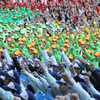 Farmers call on the central government to ditch plans to join the U.S.-led Trans-Pacific Partnership trade agreement, during a rally in Tokyo in October 2011.   BLOOMBERG