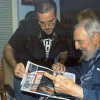 Fidel Castro seen in photos for first time in months