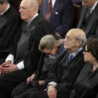 Supreme Court Justice Ruth Bader Ginsburg (center) rests during President Barack Obama's State of the Union address on Capitol Hill in Washington on Jan. 20. Ginsburg has a confession: She 'wasn't 100 percent sober' when she fell asleep at the address last month. | AP