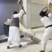Men use sledgehammers on a toppled statue in a museum at a location said to be Mosul in this still image taken from an undated video. Ultra-radical Islamist militants in northern Iraq have destroyed a priceless collection of statues and sculptures from the ancient Assyrian era, inflicting what an archaeologist described as incalculable damage to a piece of shared human history. The video, published by Islamic State on Thursday, showed men attacking the artefacts, some of them identified as antiquities from the 7th century BC, with sledgehammers and drills, saying they were symbols of idolatry. | REUTERS