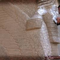 An image grab taken off a video reportedly released by media office of the Nineveh branch of the Islamic State group on Wednesday allegedly shows a militant destroying the statue of Lamassu, an Assyrian diety, with a jackhammer in the northern Iraqi Governorate of Nineveh. | AFP-JIJI