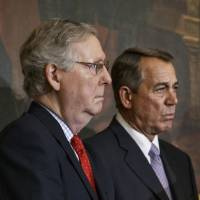 Senate Majority Leader Mitch McConnell of Kentucky (left) and House Speaker John Boehner of Ohio stand together on Capitol Hill Friday, during a ceremony before the signing of the bill authorizing expansion of the Keystone XL pipeline. Though both houses of Congress are now controlled by Republicans, Boehner and McConnell are at a standstill over provisions attached to a Homeland Security spending bill aimed at blocking President Barack Obama's executive actions on immigration. | AP