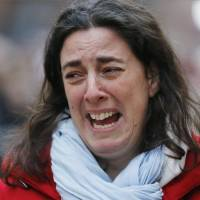 A woman cries Monday while visiting a Copenhagen synagogue where her brother was shot to death over the weekend by a gunman in what has been described as a terrorist attack. Danish Prime Minister Helle Thorning-Schmidt says she is mourning the two people killed and is vowing to protect freedom of speech along with Denmark's Jewish community.   AP