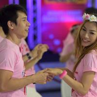 Couples take part in a dance marathon contest Friday in Pattaya, Thailand. | AFP-JIJI