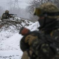 Ukrainian armed forces take their position near Debaltseve, eastern Ukraine, on Monday. Ukrainian armed forces are not ready to withdraw heavy weapons, as agreed at the Minsk four-power peace talks, because separatists are violating the cease-fire, a Kiev military spokesman said on Monday. | REUTERS