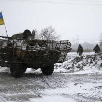 Ukrainian armed forces deploy near Debaltseve, eastern Ukraine, on Monday amid heavy fighting despite a cease-fire accord. | REUTERS