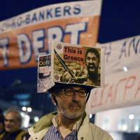 Greeks gather Monday in front of the parliament during a pro-government demonstration in Athens. | AFP-JIJI