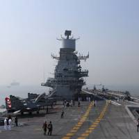 India reportedly plans to equip an aircraft carrier that would be a successor to current ships such as the INS Vikramaditya (pictured) with top-of-the-line U.S. technology to boost their range and potency, a move widely perceived as a bid to counter China's military influence in the region. | REUTERS