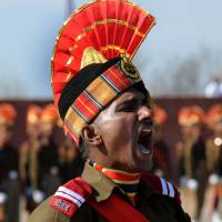 A new recruit of the Indian paramilitary Border Security Force calls recruits to attention during a passing-out parade on the outskirts of Srinagar on Jan. 30. India and China contest a number of pieces of territory. | AFP-JIJI