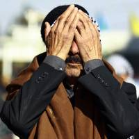An Iraqi mourns Saturday in Najaf during a funeral procession for a pro-government fighter who was killed in Ramadi during clashes with the Islamic State group. | AFP