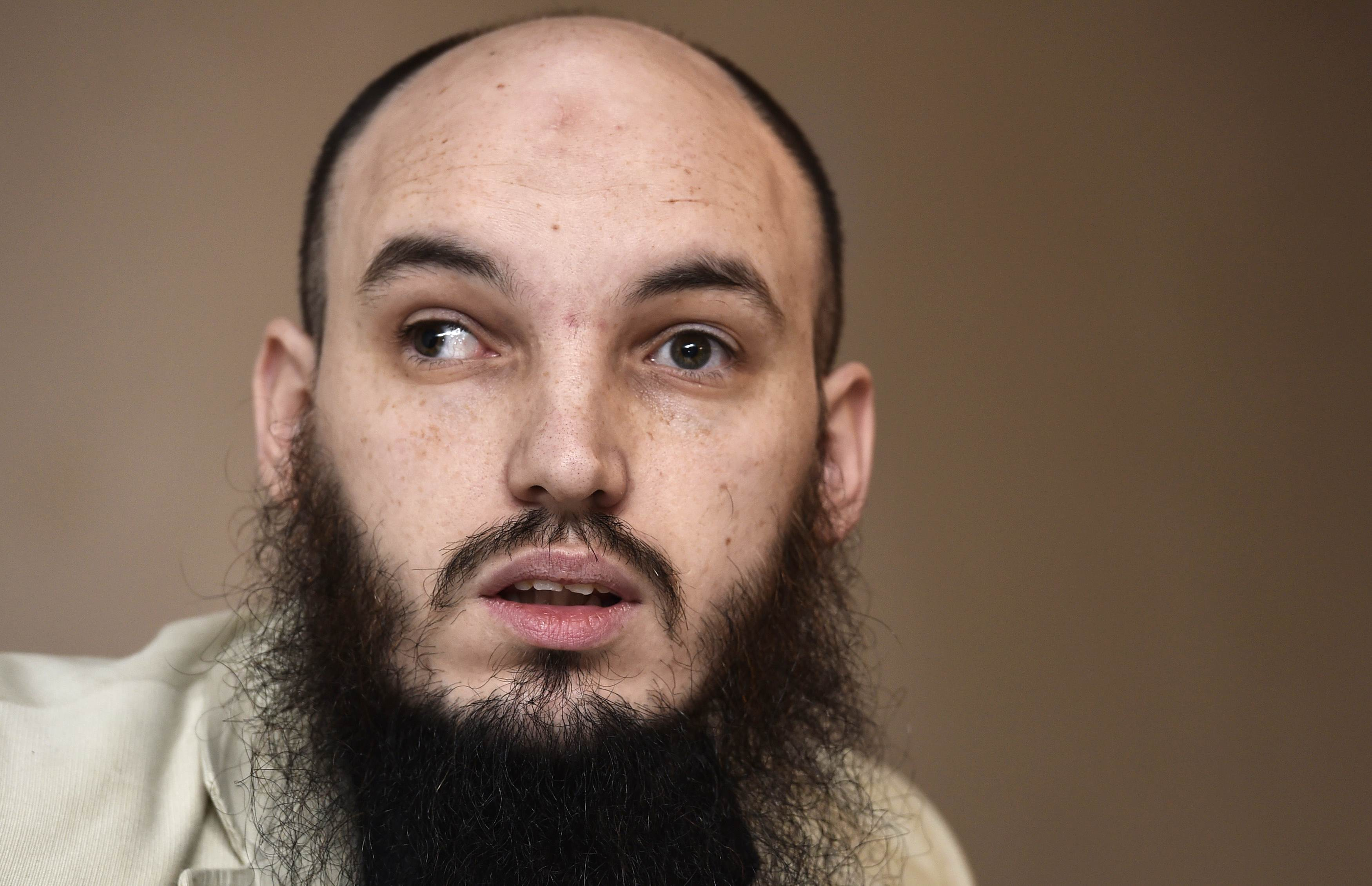 Ceri Bullivant from human rights organization Cage speaks Thursday during a news conference in London. Investigators believe the masked killer known as 'Jihadi John'  is a British man named Mohammed Emwazi, two U.S. government sources said on Thursday. Asim Qureshi, the research director of the charity Cage, which worked with Emwazi since 2009, said that although he could not be certain Emwazi was John, there were some 'striking similarities.' | REUTERS