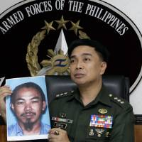 Then-Armed Forces of the Philippines spokesman Col. Marcelo Burgos shows a picture in February 2012 of Malaysian Zulkifli bin Hir, also known as Marwan, during a mews conference in suburban Quezon City, north of Manila. DNA analysis suggests that Philippine authorities have killed one of Southeast Asia's most wanted terror suspects in a recent clash with Muslim rebels, the FBI said Wednesday. | AP