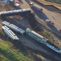 At least 30 injured after California commuter train hits truck; trucker held: media