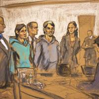In this courtroom sketch, defendants Akhror Saidakhmetov (third from left) and Abdurasul Hasanovich Juraboev (fourth from right) stand in Federal Court at their arraignment Wednesday in Brooklyn, New York. They are charged along with a third man of plotting to travel to Syria to join the Islamic State group and wage war against the U.S., and federal officials said one of them spoke of shooting President Barack Obama or planting a bomb on Coney Island. | AP