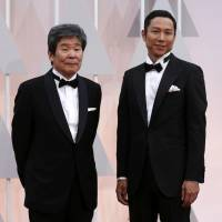 Isao Takahata (left) and Yoshiaki Nishimura, best animated film nominees for their film 'The Tale of Princess Kaguya,' arrive at the 87th Academy Awards in Hollywood, California, on Sunday. | REUTERS