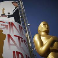 An Oscar statue stands outside the Dolby Theatre, which hosts the Academy Awards ceremonies, in Hollywood on Friday. | REUTERS
