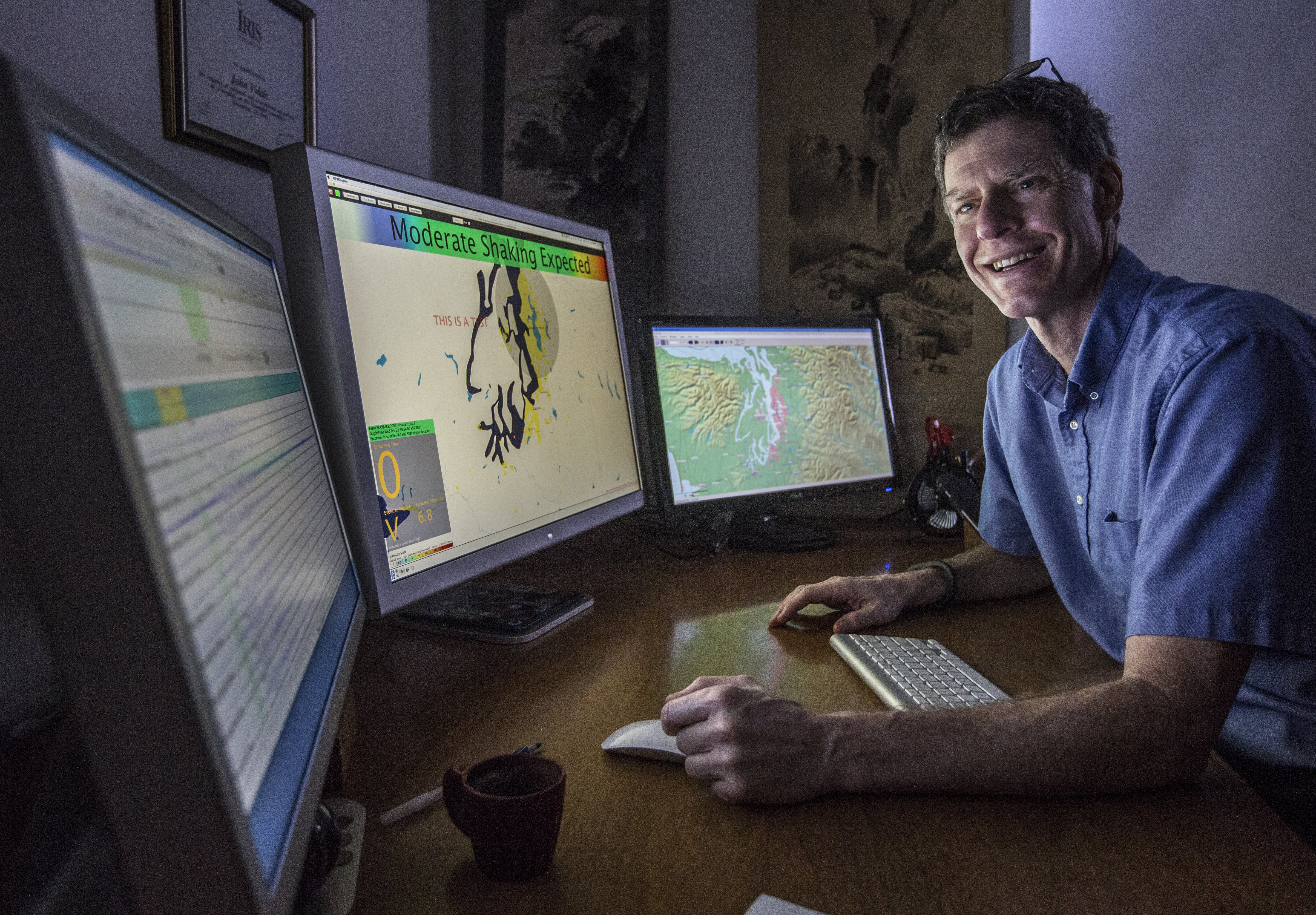 John Vidale,  director of Pacific Northwest Seismic Network, shows the earthquake early warning system at the University of Washington on Feb. 9 in Seattle. Companies including Boeing, Alaska Airlines and Intel will be able to work with the system and figure out how to make use of warning times. Tests of the system started Tuesday.   AP/THE SEATTLE TIMES, STEVE RINGMAN