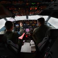 Pilots perform preflight checks aboard a P-8A before a mission from Perth, Australia, in this file image from April 2014. The plane has now made more than 180 hours of missions from the Philippines.   U.S. NAVY