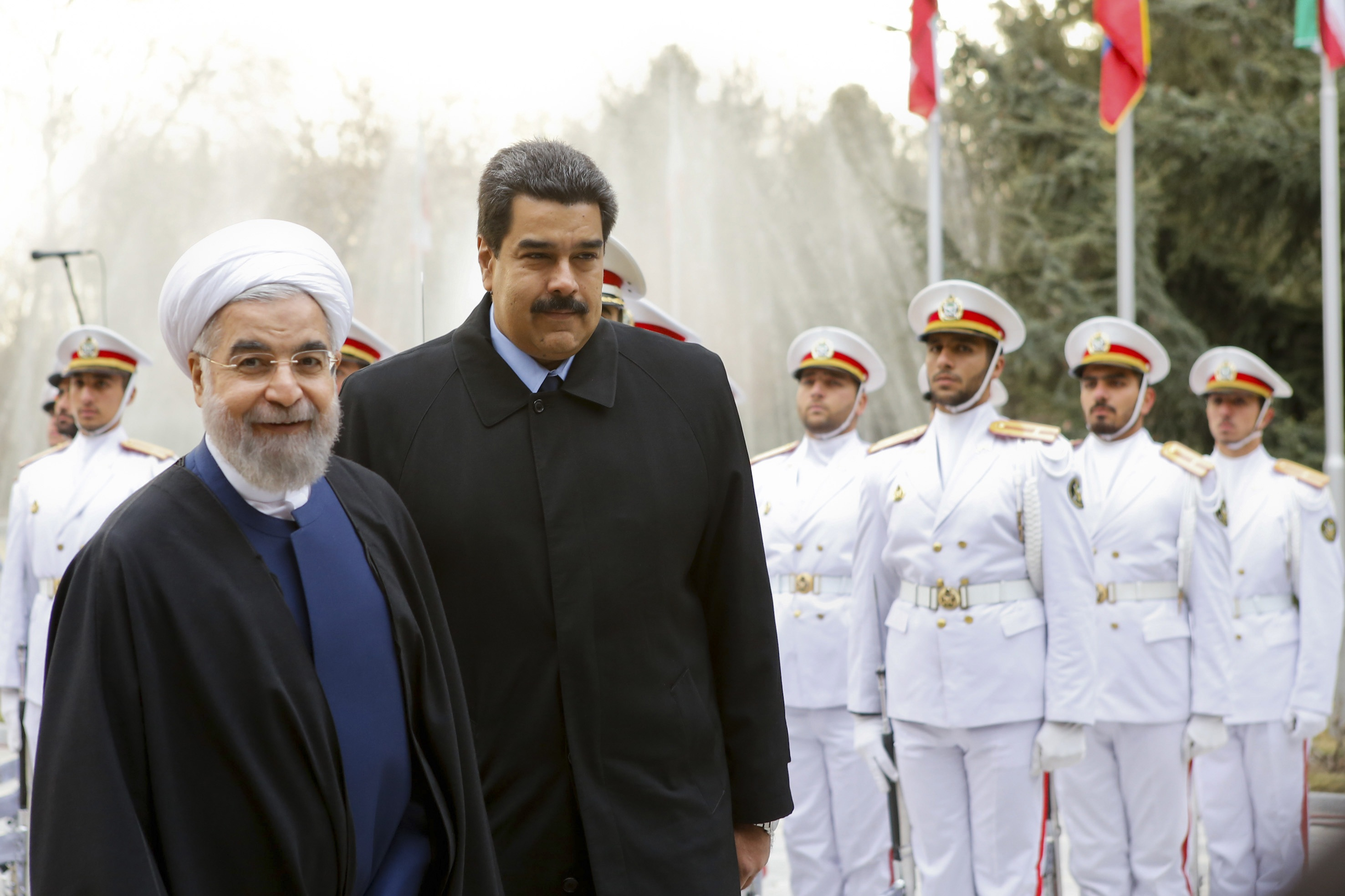 Iranian President Hassan Rouhani (left) welcomes Venezuelan President Nicolas Maduro in Tehran on Jan. 10. The reformist leader is at loggerheads with the conservative establishment, and Tehran has reportedly warned Washington that failure to win concessions could topple Rouhani.   REUTERS