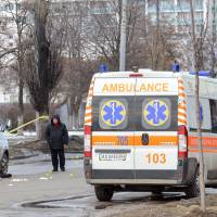 Kiev points finger at Russia after blast kills two at rally; four suspects arrested