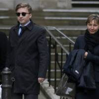Marina Litvinenko, the widow of murdered KGB agent Alexander Litvinenko, leaves after giving evidence at the High Court in central London on Monday. Alexander Litvinenko, a former Russian agent killed with polonium in London, believed Vladimir Putin lacked the mettle to stamp out corruption inside Russia's security agency and that he had links to organized crime, his widow said on Monday. | REUTERS