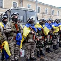Ukrainian police officers stand during a ceremony in Kharkiv, northeastern Ukrainian, on Friday ahead of their departure to the east of the country, where they were to take part in an anti-terrorist operation. | AFP