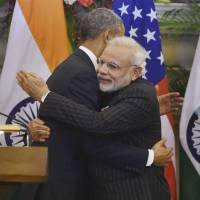 U.S. President Barack Obama and Indian Prime Minister Narendra Modi hug after jointly addressing the media following talks in New Delhi on Jan. 25. | AP