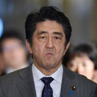 Prime Minister Shinzo Abe arrives at the Diet on Friday. On Monday in the Upper House he pushed his plan to give the Self-Defense Forces a bigger overseas role. | AFP