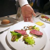 Dishes recommended by the Chef Watson app are served up at a tasting event at a French restaurant in Minato Ward, Tokyo. The app offers 100 original recipes that the user can filter by ingredients. | KYODO