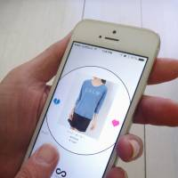 The Sensy smartphone app recommends clothes based on analysis of the user's previous input. | KYODO