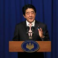 Prime Minister Shinzo Abe holds a news conference in Jerusalem on Jan. 20. | REUTERS