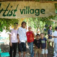 Resident of the southern Philippine island of Siquijor attend the opening ceremony for the artists' village on Jan. 10. The two men on the left are former students of Koji Kuwabara. | KYODO