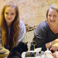 Customers enjoy their tea in the presence of cats at a cafe in London in December. | KYODO