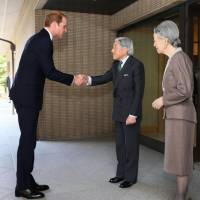 Britain's Prince William is greeted by Emperor Akihito and Empress Michiko at the Imperial Palace on Friday. | KYODO