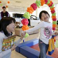 Auto dealerships perform double duty as venue for after-school English classes