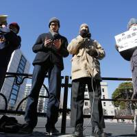 Muslims living in Japan join others for an interfaith prayer vigil in front of the prime minister's official residence in Tokyo on Monday for two Japanese hostages purportedly beheaded by the Islamic State group.   AP