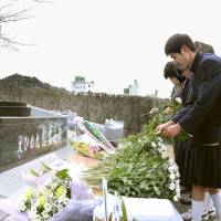 Mourners mark 14 years since Ehime Maru collision