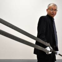 Sword maker Sadanao Mikami shows off a 'Spear of Longinus' modeled after a weapon in the popular anime series 'Neon Genesis Evangelion' at a sword museum in Okayama Prefecture in May 2012. The one that the volunteer group wants to stick in the moon is only 24 cm long and weighs 30 grams. | KYODO