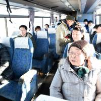Passengers taking a bus bound for JR Haranomachi Station in Fukushima Prefecture wait for it to depart JR Tatsuta Station, also in the prefecture, on Jan. 31. | FUKUSHIMA MINPO