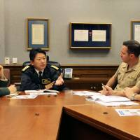 Japanese defense attaches meet with officials of the U.S. Joint Chiefs of Staff in the Pentagon in Washington in December. The government is considering increasing the number of defense attaches at embassies around the world to strengthen intelligence capabilities. | KYODO