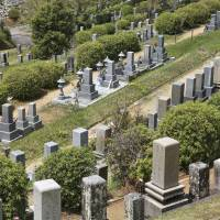 The Nagoyama Cemetery in Himeji, Hyogo Prefecture, hosts the graves of 110,000 soldiers. With half a million people expected to die in Japan each year for the next five years, there are too few relatives left in many rural areas to look after family graves. | ISTOCK