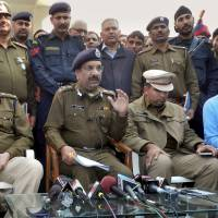 Indian police address the media as they announce the arrest of eight men suspected of brutally raping and killing a Nepalese woman in Rohtak, Haryana state, India, on Monday. Police were also searching Monday for a man who raped a Japanese student sightseeing in northern India. | AP