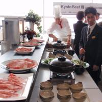 A chef cooks 'Kyoto Beef' during a ceremony at a hotel in Izumisano, Osaka Prefecture, on Feb. 2, marking the start of exports of high quality beef to Singapore from nearby Kyoto, via Kansai International Airport. | KYODO