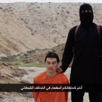 A screenshot of a purportedly Islamic State video uploaded early Sunday morning shows captured Japanese journalist Kenji Goto. A still image included in the video appears to show Goto's dead body.