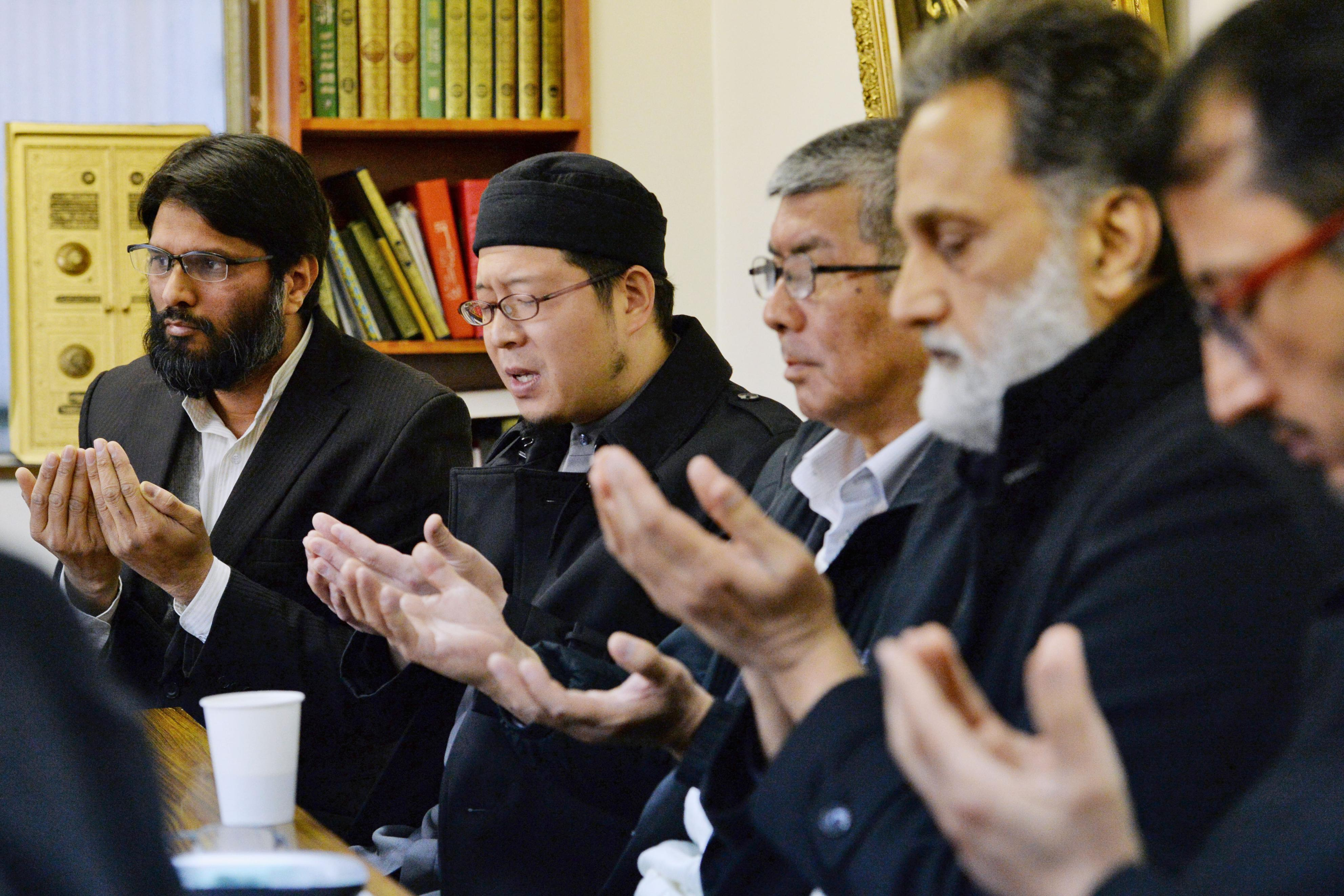 Muslims from various places in Japan gather Feb. 1 at Otsuka Mosque in Toshima Ward, Tokyo, to pray for hostage Kenji Goto. | KYODO