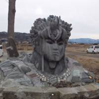 A screen grab from Youtube shows a mystery stone sculputure sitting along Chikuma River in Ueda, Nagano Prefecture. | YOUTUBE
